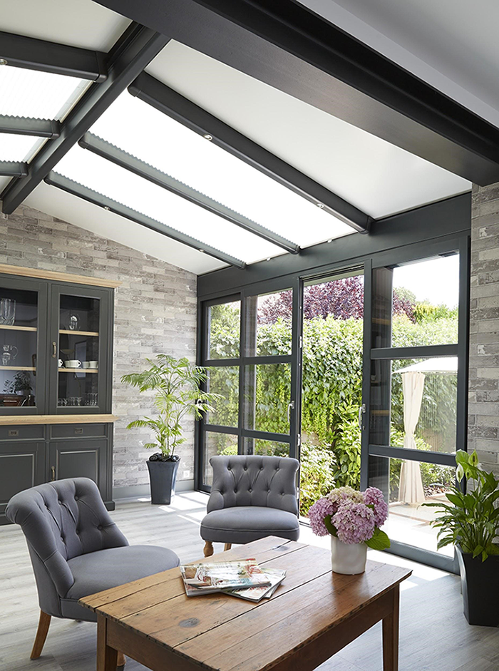 Une toiture mixte pour véranda